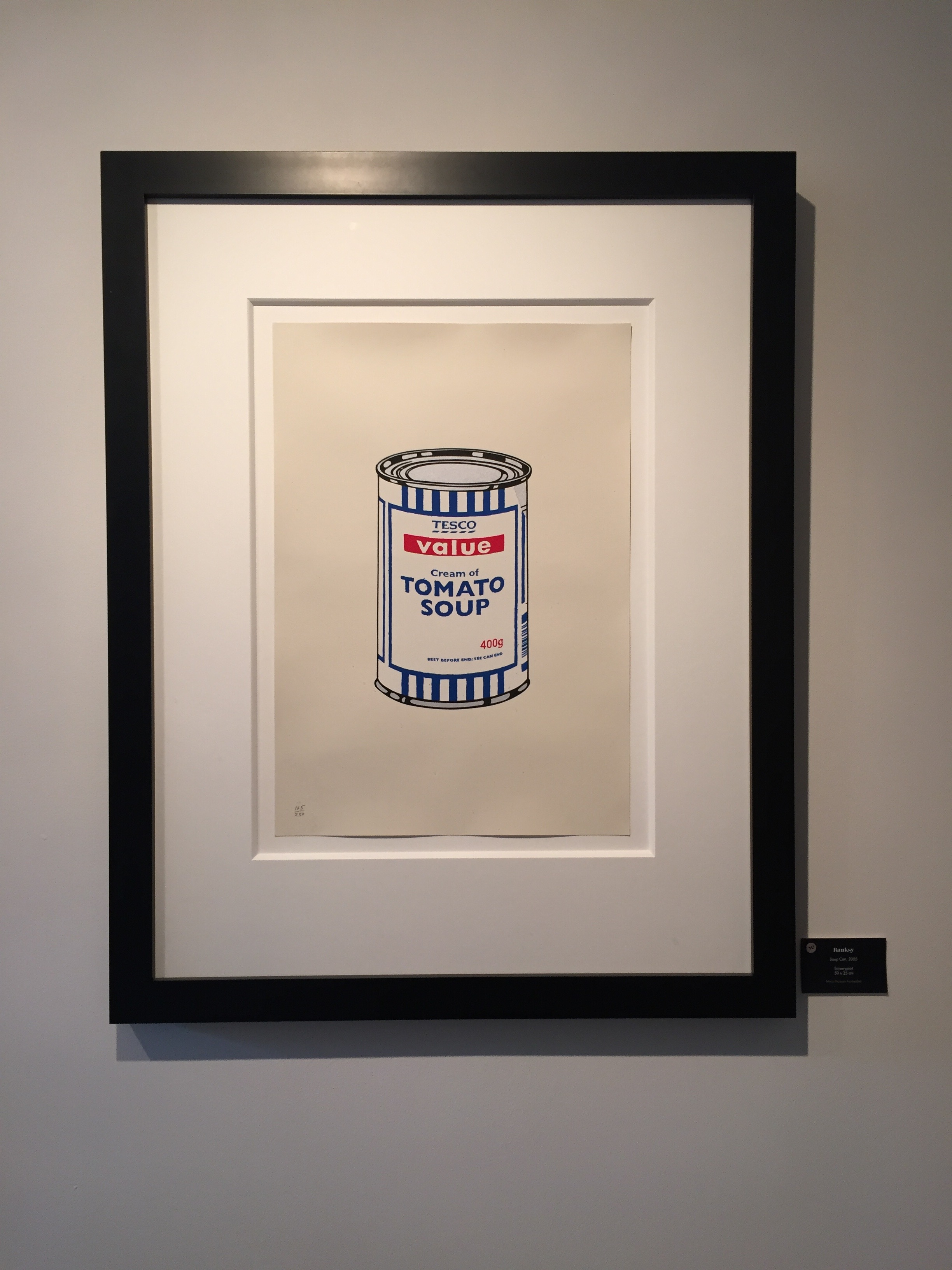 framed Banksy Tesco Soup Can Poster inside the Moco Museum in Amsterdam