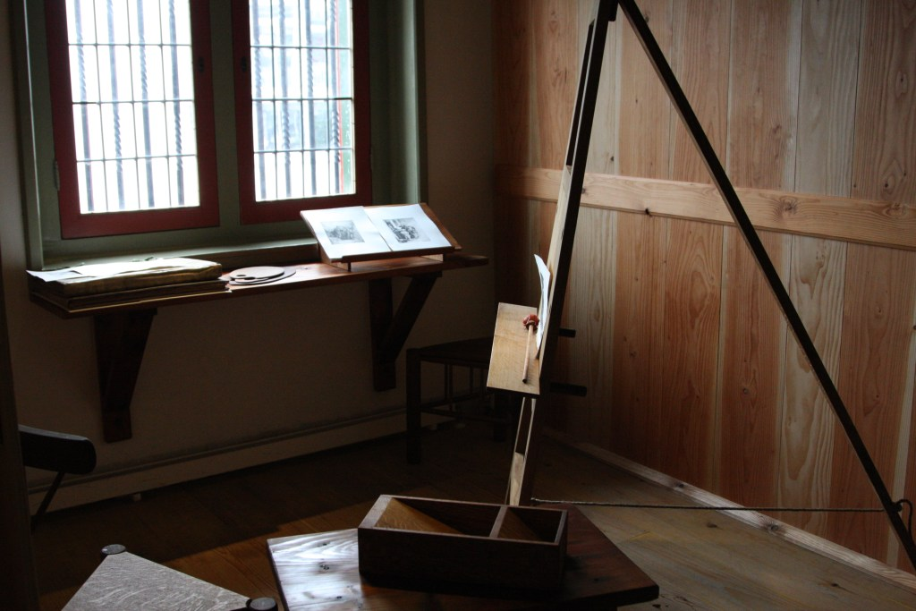 Easel in front of a window in Museum Het Rembrandthuis in Amsterdam