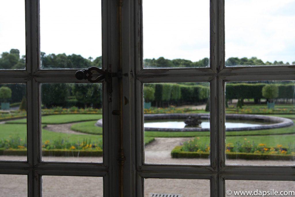 Palace of Versailles Garden through the Window in Paris Sights
