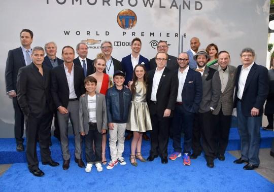"ANAHEIM, CA - MAY 09: Cast and crew of the film attend the world premiere of Disney's ""Tomorrowland"" at Disneyland, Anaheim on May 9, 2015 in Anaheim, California. (Photo by Alberto E. Rodriguez/Getty Images for Disney) *** Local Caption *** George Clooney;Tim McGraw;Britt Robertson;Raffey Cassidy;Thomas Robinson;Pierce Gagnon;Kathryn Hahn;Brad Bird;Damon Lindelof;Michael Giacchino;Richard Sherman;Alan Horn;Keegan-Michael Key;Tom Peitzman;Matthew McCaull;John Walker;Jeffrey Chernov;Brigham Taylor;Jeff Jensen"
