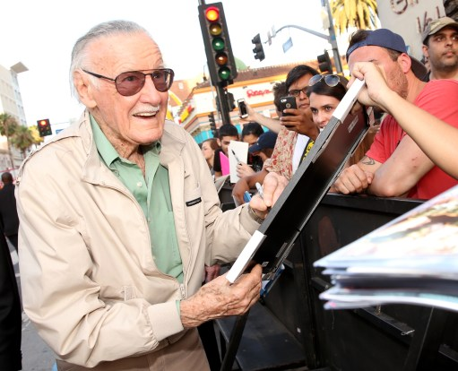 """LOS ANGELES, CA - JUNE 29: Comic book icon Stan Lee signs autographs for fans at the world premiere of Marvel's """"Ant-Man"""" at The Dolby Theatre on June 29, 2015 in Los Angeles, California. (Photo by Jesse Grant/Getty Images for Disney) *** Local Caption *** Stan Lee"""