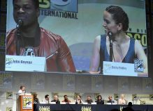 SAN DIEGO, CA - JULY 10: (L-R) Moderator Chris Hardwick, producer Kathleen Kennedy, director J.J. Abrams, screenwriter Lawrence Kasdan and actors John Boyega, Daisy Ridley, Oscar Isaac, Adam Driver, Domhnall Gleeson and Gwendoline Christie at the Hall H Panel for `Star Wars: The Force Awakens` during Comic-Con International 2015 at the San Diego Convention Center on July 10, 2015 in San Diego, California. (Photo by Michael Buckner/Getty Images for Disney) *** Local Caption *** Chris Hardwick; Kathleen Kennedy; J.J. Abrams; Lawrence Kasdan; John Boyega; Daisy Ridley; Oscar Isaac; Adam Driver; Domhnall Gleeson; Gwendoline Christie