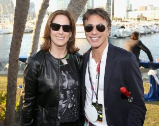 SAN DIEGO, CA - JULY 10: Producer Kathleen Kennedy (L), President of Marketing, The Walt Disney Studios, Ricky Strauss and more than 6000 fans enjoyed a surprise `Star Wars` Fan Concert performed by the San Diego Symphony, featuring the classic `Star Wars` music of composer John Williams, at the Embarcadero Marina Park South on July 10, 2015 in San Diego, California. (Photo by Jesse Grant/Getty Images for Disney) *** Local Caption *** Kathleen Kennedy; Ricky Strauss