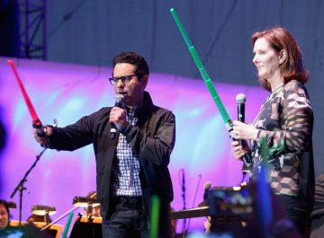 "SAN DIEGO, CA - JULY 10: Director J.J. Abrams (L), producer Kathleen Kennedy and more than 6000 fans enjoyed a surprise `Star Wars` Fan Concert performed by the San Diego Symphony, featuring the classic ""Star Wars"" music of composer John Williams, at the Embarcadero Marina Park South on July 10, 2015 in San Diego, California. (Photo by Jesse Grant/Getty Images for Disney) *** Local Caption *** J.J. Abrams; Kathleen Kennedy"