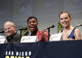 SAN DIEGO, CA - JULY 10: (L-R) Screenwriter Lawrence Kasdan and actors John Boyega and Daisy Ridley at the Hall H Panel for `Star Wars: The Force Awakens` during Comic-Con International 2015 at the San Diego Convention Center on July 10, 2015 in San Diego, California. (Photo by Jesse Grant/Getty Images for Disney) *** Local Caption *** Lawrence Kasdan; John Boyega; Daisy Ridley