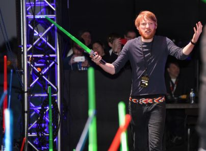 """SAN DIEGO, CA - JULY 10: Actor Domhnall Gleeson and more than 6000 fans enjoyed a surprise """"Star Wars"""" Fan Concert performed by the San Diego Symphony, featuring the classic """"Star Wars"""" music of composer John Williams, at the Embarcadero Marina Park South on July 10, 2015 in San Diego, California. (Photo by Michael Buckner/Getty Images for Disney) *** Local Caption *** Domhnall Gleeson"""
