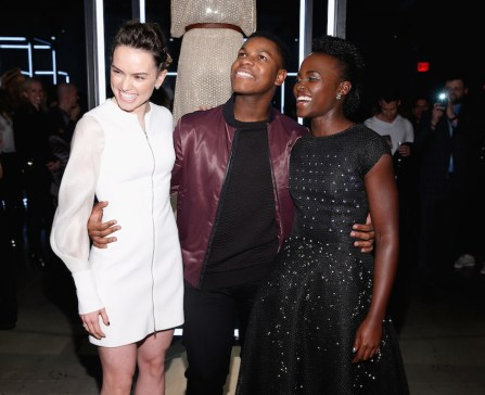 """NEW YORK, NY - DECEMBER 02: (L-R) Actors Daisy Ridley, Lupita Nyong'o, and John Boyega attend the Star Wars """"Force 4 Fashion"""" Event on Dec. 2 at the Skylight Modern in NYC. Top designers showcased bespoke looks inspired by characters from Star Wars: The Force Awakens that will be auctioned off for Bloomingdale?s holiday charity. (Photo by Brian Ach/Getty Images for Disney Consumer Products)"""