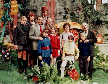 Full publicity shot of Michael Bollner as Augustus Gloop, Ursula Reit as Mrs. Gloop, Gene Wilder as Willy Wonka, Leonard Stone as Mr. Beauregarde, Denise Nickerson as Violet Beauregarde, Roy Kinnear as Mr. Salt, Julie Dawn Cole as Veruca Salt, Dodo Denney as Mrs. Teevee, Paris Themmen as Mike Teevee, Jack Albertson as Grandpa Joe and Peter Ostrum as Charlie standing in Chocolate Room.