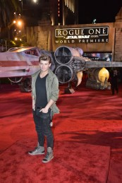 "HOLLYWOOD, CA - DECEMBER 10: Actor Garrett Clayton attends The World Premiere of Lucasfilm's highly anticipated, first-ever, standalone Star Wars adventure, ""Rogue One: A Star Wars Story"" at the Pantages Theatre on December 10, 2016 in Hollywood, California. (Photo by Marc Flores/Getty Images for Disney) *** Local Caption *** Garrett Clayton"