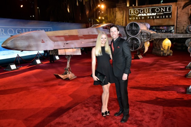 """HOLLYWOOD, CA - DECEMBER 10: Actress Carly Schroeder (L) and guest attend The World Premiere of Lucasfilm's highly anticipated, first-ever, standalone Star Wars adventure, """"Rogue One: A Star Wars Story"""" at the Pantages Theatre on December 10, 2016 in Hollywood, California. (Photo by Marc Flores/Getty Images for Disney) *** Local Caption *** Carly Schroeder"""