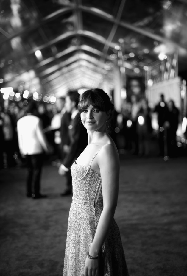 "HOLLYWOOD, CA - DECEMBER 10: (EDITORS NOTE: Image has been shot in black and white. Color version not available.) Actress Felicity Jones attends The World Premiere of Lucasfilm's highly anticipated, first-ever, standalone Star Wars adventure, ""Rogue One: A Star Wars Story"" at the Pantages Theatre on December 10, 2016 in Hollywood, California. (Photo by Charley Gallay/Getty Images for Disney) *** Local Caption *** Felicity Jones"