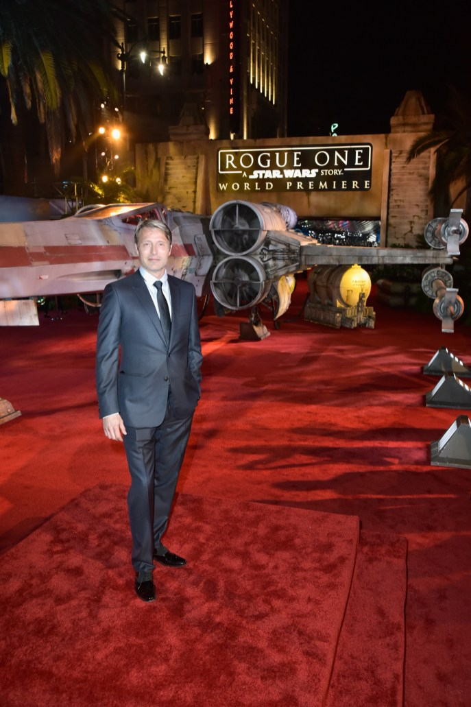 """HOLLYWOOD, CA - DECEMBER 10: Actor Mads Mikkelsen attends The World Premiere of Lucasfilm's highly anticipated, first-ever, standalone Star Wars adventure, """"Rogue One: A Star Wars Story"""" at the Pantages Theatre on December 10, 2016 in Hollywood, California. (Photo by Marc Flores/Getty Images for Disney) *** Local Caption *** Mads Mikkelsen"""