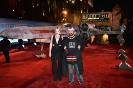 "HOLLYWOOD, CA - DECEMBER 10: Actress Harley Quinn Smith (L) and director Kevin Smith attend The World Premiere of Lucasfilm's highly anticipated, first-ever, standalone Star Wars adventure, ""Rogue One: A Star Wars Story"" at the Pantages Theatre on December 10, 2016 in Hollywood, California. (Photo by Marc Flores/Getty Images for Disney) *** Local Caption *** Harley Quinn Smith; Kevin Smith"