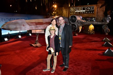 "HOLLYWOOD, CA - DECEMBER 10: Writer Holiday Reinhorn, actor Rainn Wilson and Walter McKenzie Wilson attend The World Premiere of Lucasfilm's highly anticipated, first-ever, standalone Star Wars adventure, ""Rogue One: A Star Wars Story"" at the Pantages Theatre on December 10, 2016 in Hollywood, California. (Photo by Marc Flores/Getty Images for Disney) *** Local Caption *** Holiday Reinhorn; Rainn Wilson; Walter McKenzie"