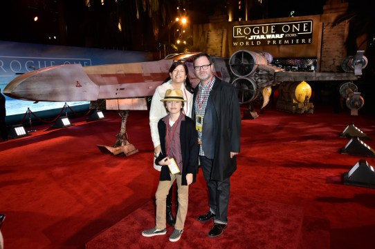 """HOLLYWOOD, CA - DECEMBER 10: Writer Holiday Reinhorn, actor Rainn Wilson and Walter McKenzie Wilson attend The World Premiere of Lucasfilm's highly anticipated, first-ever, standalone Star Wars adventure, """"Rogue One: A Star Wars Story"""" at the Pantages Theatre on December 10, 2016 in Hollywood, California. (Photo by Marc Flores/Getty Images for Disney) *** Local Caption *** Holiday Reinhorn; Rainn Wilson; Walter McKenzie"""