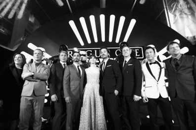 """HOLLYWOOD, CA - DECEMBER 10: (EDITORS NOTE: Image has been shot in black and white. Color version not available.) (L-R) Producer Kathleen Kennedy, actors Ben Mendelsohn, Mads Mikkelsen, Riz Ahmed, Felicity Jones, Diego Luna, Alan Tudyk, and Donnie Yen, and director Gareth Edwards attend The World Premiere of Lucasfilm's highly anticipated, first-ever, standalone Star Wars adventure, """"Rogue One: A Star Wars Story"""" at the Pantages Theatre on December 10, 2016 in Hollywood, California. (Photo by Charley Gallay/Getty Images for Disney) *** Local Caption *** Ben Mendelsohn; Riz Ahmed; Felicity Jones; Diego Luna; Donnie Yen; Mads Mikkelsen; Alan Tudyk; Gareth Edwards; Kathleen Kennedy"""