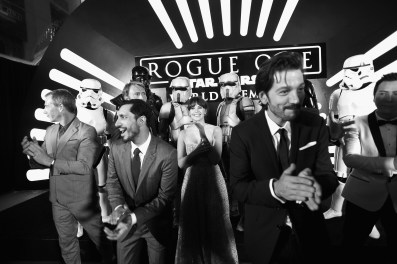 """HOLLYWOOD, CA - DECEMBER 10: (EDITORS NOTE: Image has been shot in black and white. Color version not available.) (L-R) Actors Ben Mendelsohn, Riz Ahmed, Mads Mikkelsen, Felicity Jones, Diego Luna, and Donnie Yen attend The World Premiere of Lucasfilm's highly anticipated, first-ever, standalone Star Wars adventure, """"Rogue One: A Star Wars Story"""" at the Pantages Theatre on December 10, 2016 in Hollywood, California. (Photo by Charley Gallay/Getty Images for Disney) *** Local Caption *** Ben Mendelsohn; Riz Ahmed; Felicity Jones; Diego Luna; Donnie Yen; Mads Mikkelsen"""