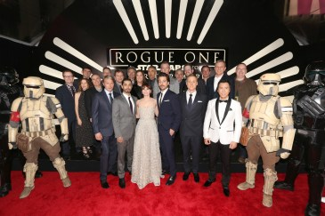 "HOLLYWOOD, CA - DECEMBER 10: (L-R front row) Actors Mads Mikkelsen, Riz Ahmed, Felicity Jones, Diego Luna, Alan Tudyk and Donnie Yen (back row) Screenwriter Chris Weitz, director Gareth Edwards, Executive producer John Knoll, Producer Allison Shearmurs, Kathleen Kennedy, Chairman, The Walt Disney Studios, Alan Horn, actor Ben Mendelsohn, composer Michael Giacchino, producer Simon Emanuel and The Walt Disney Company Chairman and CEO Bob Iger attend The World Premiere of Lucasfilm's highly anticipated, first-ever, standalone Star Wars adventure, ""Rogue One: A Star Wars Story"" at the Pantages Theatre on December 10, 2016 in Hollywood, California. (Photo by Jesse Grant/Getty Images for Disney) *** Local Caption *** Michael Giacchino; Gareth Edwards; Mads Mikkelsen; Riz Ahmed; Felicity Jones; Diego Luna; Alan Tudyk; Donnie Yen; John Knoll; Allison Shearmur; Kathleen Kennedy; Ben Mendelsohn; Bob Iger; Chris Weitz"