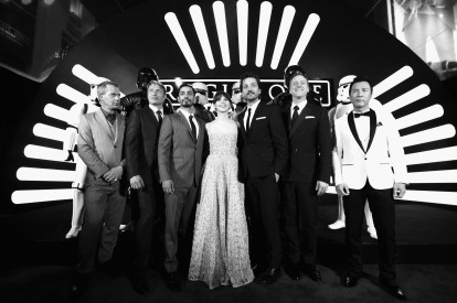"""HOLLYWOOD, CA - DECEMBER 10: (EDITORS NOTE: Image has been shot in black and white. Color version not available.) (L-R) Actors Ben Mendelsohn, Mads Mikkelsen, Riz Ahmed, Felicity Jones, Diego Luna, Alan Tudyk, and Donnie Yen attend The World Premiere of Lucasfilm's highly anticipated, first-ever, standalone Star Wars adventure, """"Rogue One: A Star Wars Story"""" at the Pantages Theatre on December 10, 2016 in Hollywood, California. (Photo by Charley Gallay/Getty Images for Disney) *** Local Caption *** Ben Mendelsohn; Riz Ahmed; Felicity Jones; Diego Luna; Donnie Yen; Mads Mikkelsen; Alan Tudyk"""