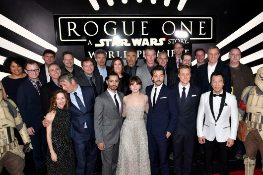 """HOLLYWOOD, CA - DECEMBER 10: (L-R front row) Producer Allison Shearmur, actors Mads Mikkelsen, Riz Ahmed, Felicity Jones, Alan Tudyk and Donnie Yen (back row) Walt Disney Studios President Alan Bergman, Screenwriter Chris Weitz, Executive producer John Knoll, director Gareth Edwards, Chairman, The Walt Disney Studios, Alan Horn, producer Kathleen Kennedy, actor Ben Mendelsohn, Executive producer Jason McGatlin, Composer Michael Giacchino, producer Simon Emanuel and The Walt Disney Company Chairman and CEO Bob Iger, attends The World Premiere of Lucasfilm's highly anticipated, first-ever, standalone Star Wars adventure, """"Rogue One: A Star Wars Story"""" at the Pantages Theatre on December 10, 2016 in Hollywood, California. (Photo by Earl Gibson III/Getty Images for Disney) *** Local Caption *** Allison Shearmur; Mads Mikkelsen; Riz Ahmed; Felicity Jones; Diego Luna; Alan Tudyk; Donnie Yen; Alan Bergman; Chris Weitz; John Knoll; Gareth Edwards; Alan Horn; Kathleen Kennedy; Ben Mendelsohn; Jason McGatlin; Michael Giacchino; Simon Emanuel; Bob Iger"""
