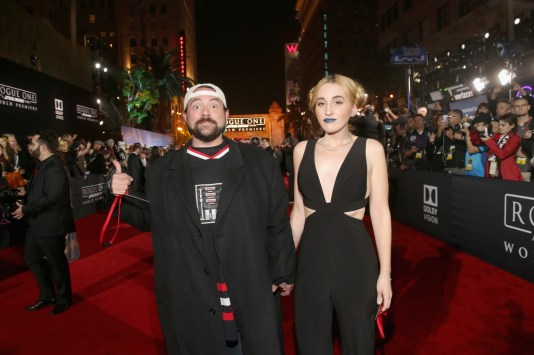 """HOLLYWOOD, CA - DECEMBER 10: Filmmaker Kevin Smith (L) and Harley Quinn Smith attend The World Premiere of Lucasfilm's highly anticipated, first-ever, standalone Star Wars adventure, """"Rogue One: A Star Wars Story"""" at the Pantages Theatre on December 10, 2016 in Hollywood, California. (Photo by Jesse Grant/Getty Images for Disney) *** Local Caption *** Kevin Smith; Harley Quinn Smith"""