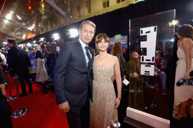 "HOLLYWOOD, CA - DECEMBER 10: Actors Mads Mikkelsen (L) and Felicity Jones attend The World Premiere of Lucasfilm's highly anticipated, first-ever, standalone Star Wars adventure, ""Rogue One: A Star Wars Story"" at the Pantages Theatre on December 10, 2016 in Hollywood, California. (Photo by Charley Gallay/Getty Images for Disney) *** Local Caption *** Mads Mikkelsen; Felicity Jones"