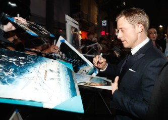 """HOLLYWOOD, CA - DECEMBER 10: Actor Alan Tudyk signs autographs at The World Premiere of Lucasfilm's highly anticipated, first-ever, standalone Star Wars adventure, """"Rogue One: A Star Wars Story"""" at the Pantages Theatre on December 10, 2016 in Hollywood, California. (Photo by Rich Polk/Getty Images for Disney) *** Local Caption *** Alan Tudyk"""