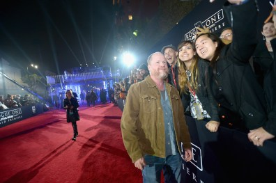 """HOLLYWOOD, CA - DECEMBER 10: Director Joss Whedon (L) takes a selfie with fans at The World Premiere of Lucasfilm's highly anticipated, first-ever, standalone Star Wars adventure, """"Rogue One: A Star Wars Story"""" at the Pantages Theatre on December 10, 2016 in Hollywood, California. (Photo by Charley Gallay/Getty Images for Disney) *** Local Caption *** Joss Whedon"""