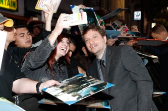 "HOLLYWOOD, CA - DECEMBER 10: Director Gareth Edwards (R) poses for a selfie with fans at The World Premiere of Lucasfilm's highly anticipated, first-ever, standalone Star Wars adventure, ""Rogue One: A Star Wars Story"" at the Pantages Theatre on December 10, 2016 in Hollywood, California. (Photo by Rich Polk/Getty Images for Disney) *** Local Caption *** Gareth Edwards"