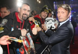"""HOLLYWOOD, CA - DECEMBER 10: Actor Mads Mikkelsen (R) signs autographs for fans at The World Premiere of Lucasfilm's highly anticipated, first-ever, standalone Star Wars adventure, """"Rogue One: A Star Wars Story"""" at the Pantages Theatre on December 10, 2016 in Hollywood, California. (Photo by Jesse Grant/Getty Images for Disney) *** Local Caption *** Mads Mikkelsen"""