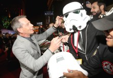 """HOLLYWOOD, CA - DECEMBER 10: Actor Ben Mendelsohn signs a costumed fan's helmet at The World Premiere of Lucasfilm's highly anticipated, first-ever, standalone Star Wars adventure, """"Rogue One: A Star Wars Story"""" at the Pantages Theatre on December 10, 2016 in Hollywood, California. (Photo by Jesse Grant/Getty Images for Disney) *** Local Caption *** Ben Mendelsohn"""