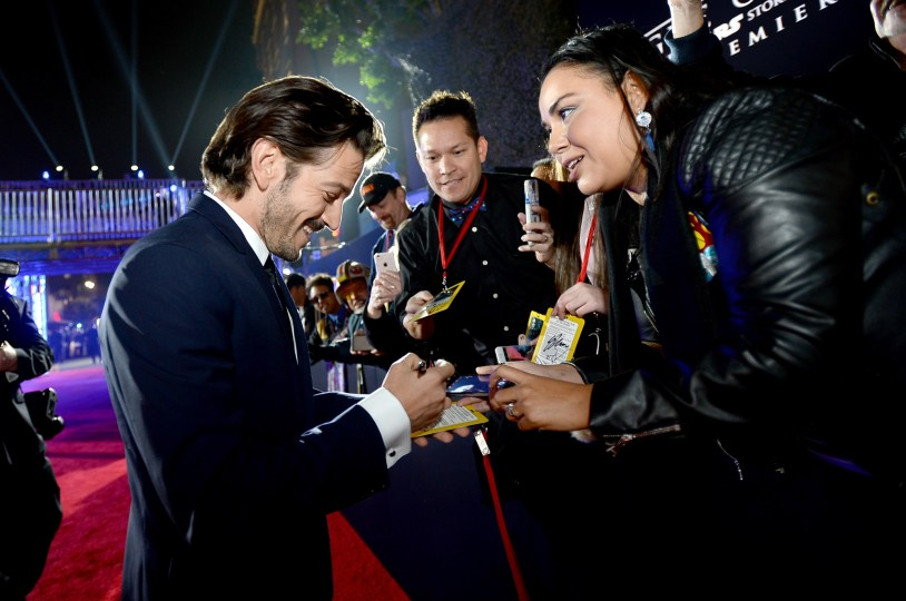 """HOLLYWOOD, CA - DECEMBER 10: Actor Diego Luna (L) signs autographs for fans at The World Premiere of Lucasfilm's highly anticipated, first-ever, standalone Star Wars adventure, """"Rogue One: A Star Wars Story"""" at the Pantages Theatre on December 10, 2016 in Hollywood, California. (Photo by Charley Gallay/Getty Images for Disney) *** Local Caption *** Diego Luna"""