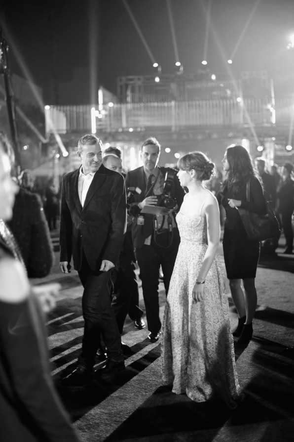"""HOLLYWOOD, CA - DECEMBER 10: (EDITORS NOTE: Image has been shot in black and white. Color version not available.) The Walt Disney Company Chairman/CEO Bob Iger (L) and actress Felicity Jones attend The World Premiere of Lucasfilm's highly anticipated, first-ever, standalone Star Wars adventure, """"Rogue One: A Star Wars Story"""" at the Pantages Theatre on December 10, 2016 in Hollywood, California. (Photo by Charley Gallay/Getty Images for Disney) *** Local Caption *** Felicity Jones; Bob Iger"""