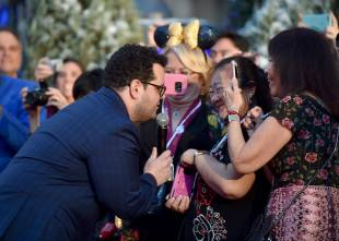 """LOS ANGELES, CA - MARCH 02: Actor Josh Gad performs at the world premiere of Disney's live-action """"Beauty and the Beast"""" at the El Capitan Theatre in Hollywood as the cast and filmmakers continue their worldwide publicity tour on March 2, 2017 in Los Angeles, California. (Photo by Alberto E. Rodriguez/Getty Images for Disney) *** Local Caption *** Josh Gad"""