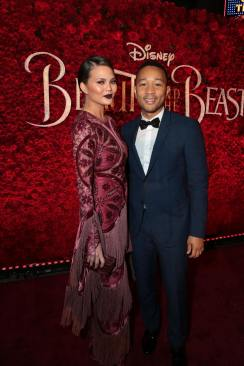 """Chrissy Tiegen and John Legend arrive for the world premiere of Disney's live-action """"Beauty and the Beast"""" at the El Capitan Theatre in Hollywood as the cast and filmmakers continue their worldwide publicity tour. (Photo: Alex J. Berliner/ABImages)"""