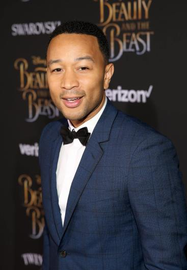 "LOS ANGELES, CA - MARCH 02: Singer John Legend arrives for the world premiere of Disney's live-action ""Beauty and the Beast"" at the El Capitan Theatre in Hollywood as the cast and filmmakers continue their worldwide publicity tour on March 2, 2017 in Los Angeles, California. (Photo by Jesse Grant/Getty Images for Disney) *** Local Caption *** John Legend"