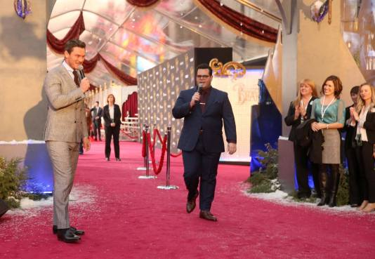 """LOS ANGELES, CA - MARCH 02: Actors Luke Evans and Josh Gad perform at the world premiere of Disney's live-action """"Beauty and the Beast"""" at the El Capitan Theatre in Hollywood as the cast and filmmakers continue their worldwide publicity tour on March 2, 2017 in Los Angeles, California. (Photo by Jesse Grant/Getty Images for Disney) *** Local Caption *** Luke Evans; Josh Gad"""
