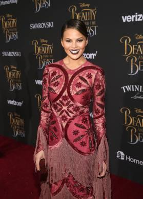 """LOS ANGELES, CA - MARCH 02: Model Chrissy Teigen arrives for the world premiere of Disney's live-action """"Beauty and the Beast"""" at the El Capitan Theatre in Hollywood as the cast and filmmakers continue their worldwide publicity tour on March 2, 2017 in Los Angeles, California. (Photo by Jesse Grant/Getty Images for Disney) *** Local Caption *** Chrissy Teigen"""