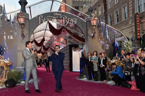 """LOS ANGELES, CA - MARCH 02: Actors Luke Evans and Josh Gad perform at the world premiere of Disney's live-action """"Beauty and the Beast"""" at the El Capitan Theatre in Hollywood as the cast and filmmakers continue their worldwide publicity tour on March 2, 2017 in Los Angeles, California. (Photo by Alberto E. Rodriguez/Getty Images for Disney) *** Local Caption *** Luke Evans; Josh Gad"""