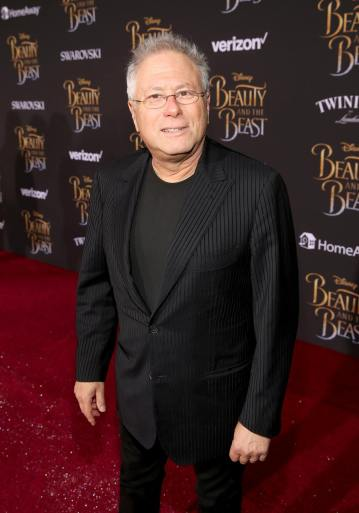 """LOS ANGELES, CA - MARCH 02: Composer Alan Menken arrives for the world premiere of Disney's live-action """"Beauty and the Beast"""" at the El Capitan Theatre in Hollywood as the cast and filmmakers continue their worldwide publicity tour on March 2, 2017 in Los Angeles, California. (Photo by Jesse Grant/Getty Images for Disney) *** Local Caption *** Alan Menken"""