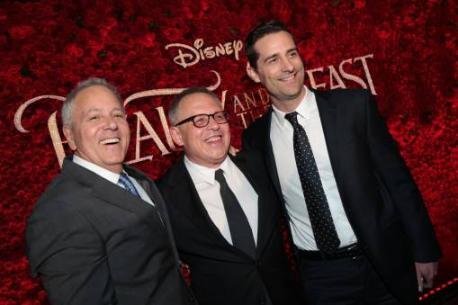"""David Hoberman, Bill Condon, Todd Lieberman pose together during the world premiere of Disney's live-action """"Beauty and the Beast"""" at the El Capitan Theatre in Hollywood as the cast and filmmakers continue their worldwide publicity tour. (Photo: Alex J. Berliner/ABImages)"""
