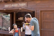 Family eating in front of Berry Stand