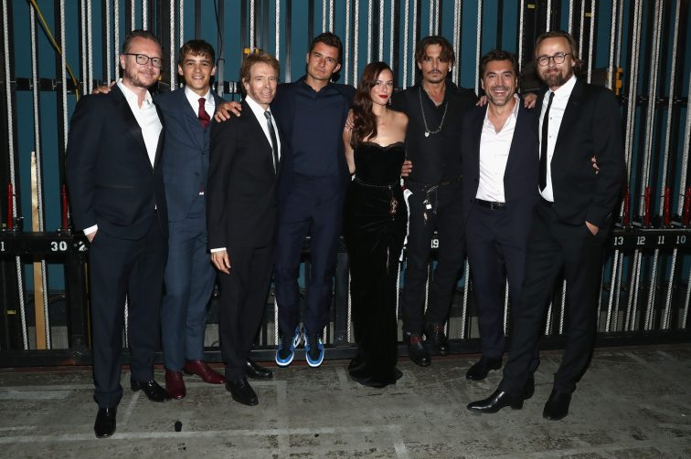 """HOLLYWOOD, CA - MAY 18: (L-R) Director Espen Sandberg, Actor Brenton Thwaites, Producer Jerry Bruckheimer, actors Orlando Bloom, Kaya Scodelario, Johnny Depp, Javier Bardem and Director Joachim Ronning at the Premiere of Disney's and Jerry Bruckheimer Films' """"Pirates of the Caribbean: Dead Men Tell No Tales,"""" at the Dolby Theatre in Hollywood, CA with Johnny Depp as the one-and-only Captain Jack in a rollicking new tale of the high seas infused with the elements of fantasy, humor and action that have resulted in an international phenomenon for the past 13 years. May 18, 2017 in Hollywood, California. (Photo by Rich Polk/Getty Images for Disney) *** Local Caption *** Espen Sandberg; Brenton Thwaites; Jerry Bruckheimer; Orlando Bloom; Kaya Scodelario; Johnny Depp; Javier Bardem; Joachim Ronning"""