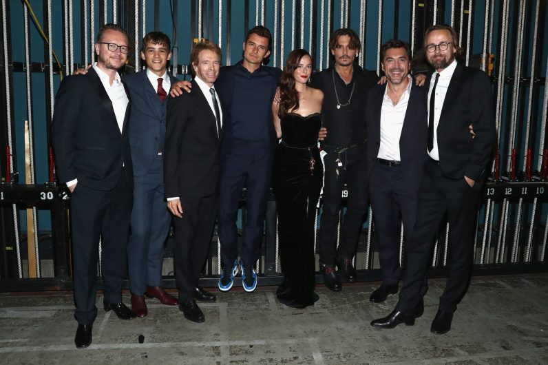 "HOLLYWOOD, CA - MAY 18: (L-R) Director Espen Sandberg, Actor Brenton Thwaites, Producer Jerry Bruckheimer, actors Orlando Bloom, Kaya Scodelario, Johnny Depp, Javier Bardem and Director Joachim Ronning at the Premiere of Disney's and Jerry Bruckheimer Films' ""Pirates of the Caribbean: Dead Men Tell No Tales,"" at the Dolby Theatre in Hollywood, CA with Johnny Depp as the one-and-only Captain Jack in a rollicking new tale of the high seas infused with the elements of fantasy, humor and action that have resulted in an international phenomenon for the past 13 years. May 18, 2017 in Hollywood, California. (Photo by Rich Polk/Getty Images for Disney) *** Local Caption *** Espen Sandberg; Brenton Thwaites; Jerry Bruckheimer; Orlando Bloom; Kaya Scodelario; Johnny Depp; Javier Bardem; Joachim Ronning"