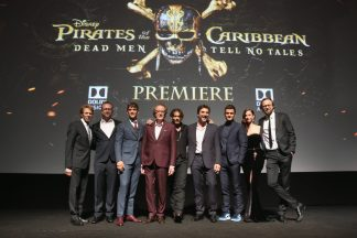 """HOLLYWOOD, CA - MAY 18: (L-R) Producer Jerry Bruckheimer, Director Espen Sandberg, actors Brenton Thwaites, Geoffrey Rush, Johnny Depp, Javier Bardem, Orlando Bloom, Kaya Scodelario and Director Joachim Ronning at the Premiere of Disney's and Jerry Bruckheimer Films' """"Pirates of the Caribbean: Dead Men Tell No Tales,"""" at the Dolby Theatre in Hollywood, CA with Johnny Depp as the one-and-only Captain Jack in a rollicking new tale of the high seas infused with the elements of fantasy, humor and action that have resulted in an international phenomenon for the past 13 years. May 18, 2017 in Hollywood, California. (Photo by Jesse Grant/Getty Images for Disney) *** Local Caption *** Jerry Bruckheimer; Espen Sandberg; Brenton Thwaites; Geoffrey Rush; Johnny Depp; Javier Bardem; Orlando Bloom; Kaya Scodelario; Joachim Ronning"""