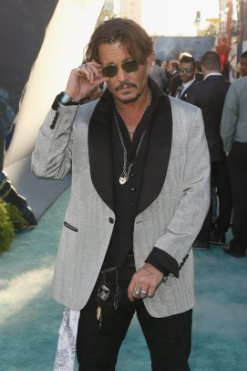 """HOLLYWOOD, CA - MAY 18: Actor Johnny Depp at the Premiere of Disney's and Jerry Bruckheimer Films' """"Pirates of the Caribbean: Dead Men Tell No Tales,"""" at the Dolby Theatre in Hollywood, CA with Johnny Depp as the one-and-only Captain Jack in a rollicking new tale of the high seas infused with the elements of fantasy, humor and action that have resulted in an international phenomenon for the past 13 years. May 18, 2017 in Hollywood, California. (Photo by Jesse Grant/Getty Images for Disney) *** Local Caption *** Johnny Depp"""