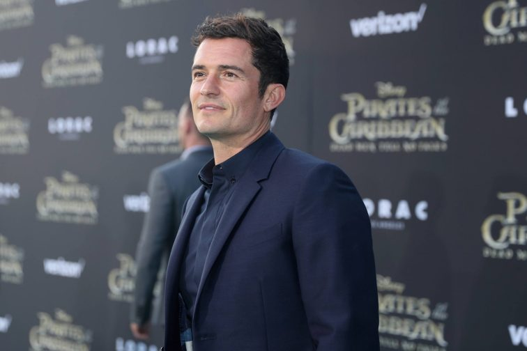 """HOLLYWOOD, CA - MAY 18: Actor Orlando Bloom at the Premiere of Disney's and Jerry Bruckheimer Films' """"Pirates of the Caribbean: Dead Men Tell No Tales,"""" at the Dolby Theatre in Hollywood, CA with Johnny Depp as the one-and-only Captain Jack in a rollicking new tale of the high seas infused with the elements of fantasy, humor and action that have resulted in an international phenomenon for the past 13 years. May 18, 2017 in Hollywood, California. (Photo by Rich Polk/Getty Images for Disney) *** Local Caption *** Orlando Bloom"""