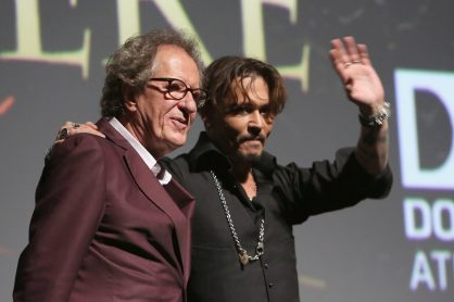 "HOLLYWOOD, CA - MAY 18: Actors Geoffrey Rush (L) and Johnny Depp at the Premiere of Disney's and Jerry Bruckheimer Films' ""Pirates of the Caribbean: Dead Men Tell No Tales,"" at the Dolby Theatre in Hollywood, CA with Johnny Depp as the one-and-only Captain Jack in a rollicking new tale of the high seas infused with the elements of fantasy, humor and action that have resulted in an international phenomenon for the past 13 years. May 18, 2017 in Hollywood, California. (Photo by Jesse Grant/Getty Images for Disney) *** Local Caption *** Geoffrey Rush; Johnny Depp"