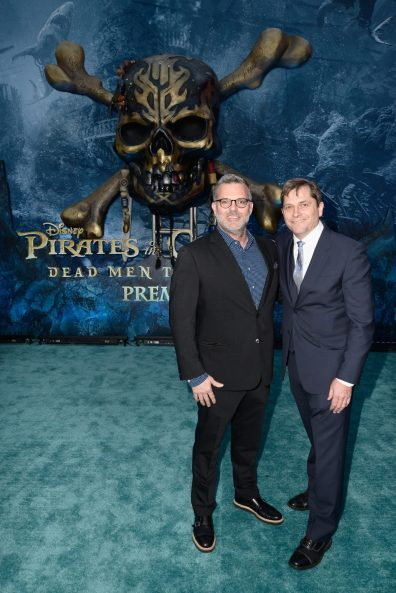 "HOLLYWOOD, CA - MAY 18: Executive producer Chad Oman (L) and EVP Production, The Walt Disney Company, Sam Dickerman at the Premiere of Disney's and Jerry Bruckheimer Films' ""Pirates of the Caribbean: Dead Men Tell No Tales,"" at the Dolby Theatre in Hollywood, CA with Johnny Depp as the one-and-only Captain Jack in a rollicking new tale of the high seas infused with the elements of fantasy, humor and action that have resulted in an international phenomenon for the past 13 years. May 18, 2017 in Hollywood, California. (Photo by Marc Flores/Getty Images for Disney) *** Local Caption *** Chad Oman; Sam Dickerman"