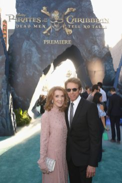 """HOLLYWOOD, CA - MAY 18: Linda Bruckheimer (L) and Producer Jerry Bruckheimer at the Premiere of Disney's and Jerry Bruckheimer Films' """"Pirates of the Caribbean: Dead Men Tell No Tales,"""" at the Dolby Theatre in Hollywood, CA with Johnny Depp as the one-and-only Captain Jack in a rollicking new tale of the high seas infused with the elements of fantasy, humor and action that have resulted in an international phenomenon for the past 13 years. May 18, 2017 in Hollywood, California. (Photo by Jesse Grant/Getty Images for Disney) *** Local Caption *** Linda Bruckheimer; Jerry Bruckheimer"""